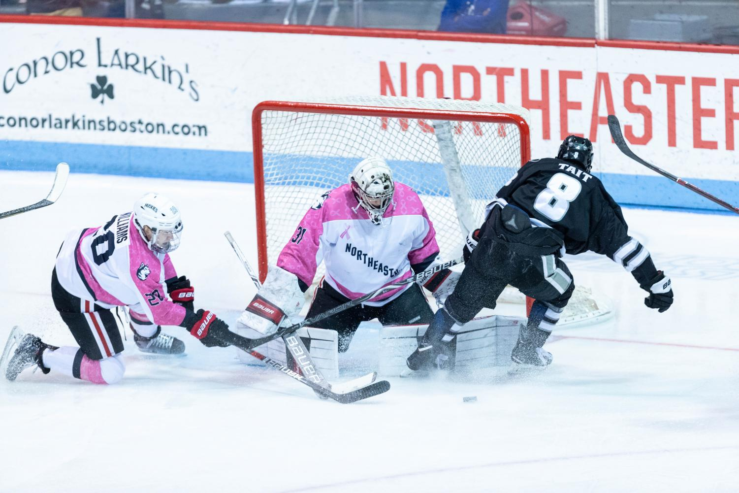 Sophomore goalkeeper Cayden Primeau drops to make a pad save in a prior game against Providence.