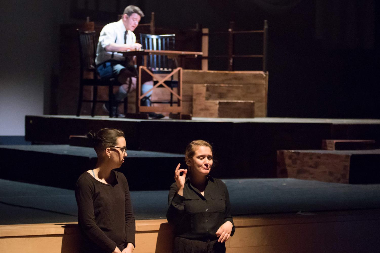 Members of NU's ASL club interpret a performance of NU Stage's