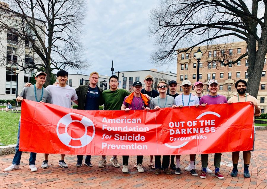 Fraternity members walk in support of mental health