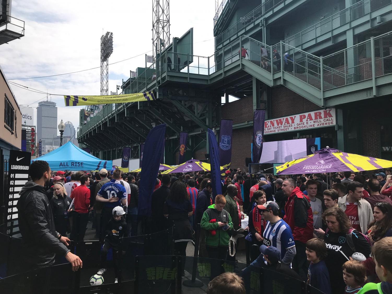 Premier League fans mill about Fenway at NBC Sports' Premier League Fan Festival.