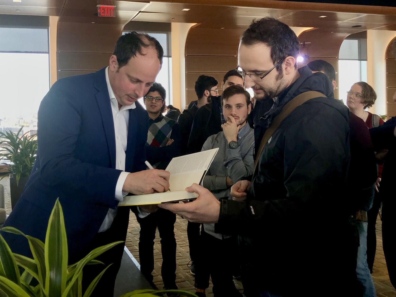 Nate Silver signs a copy of his book after the talk March 27.