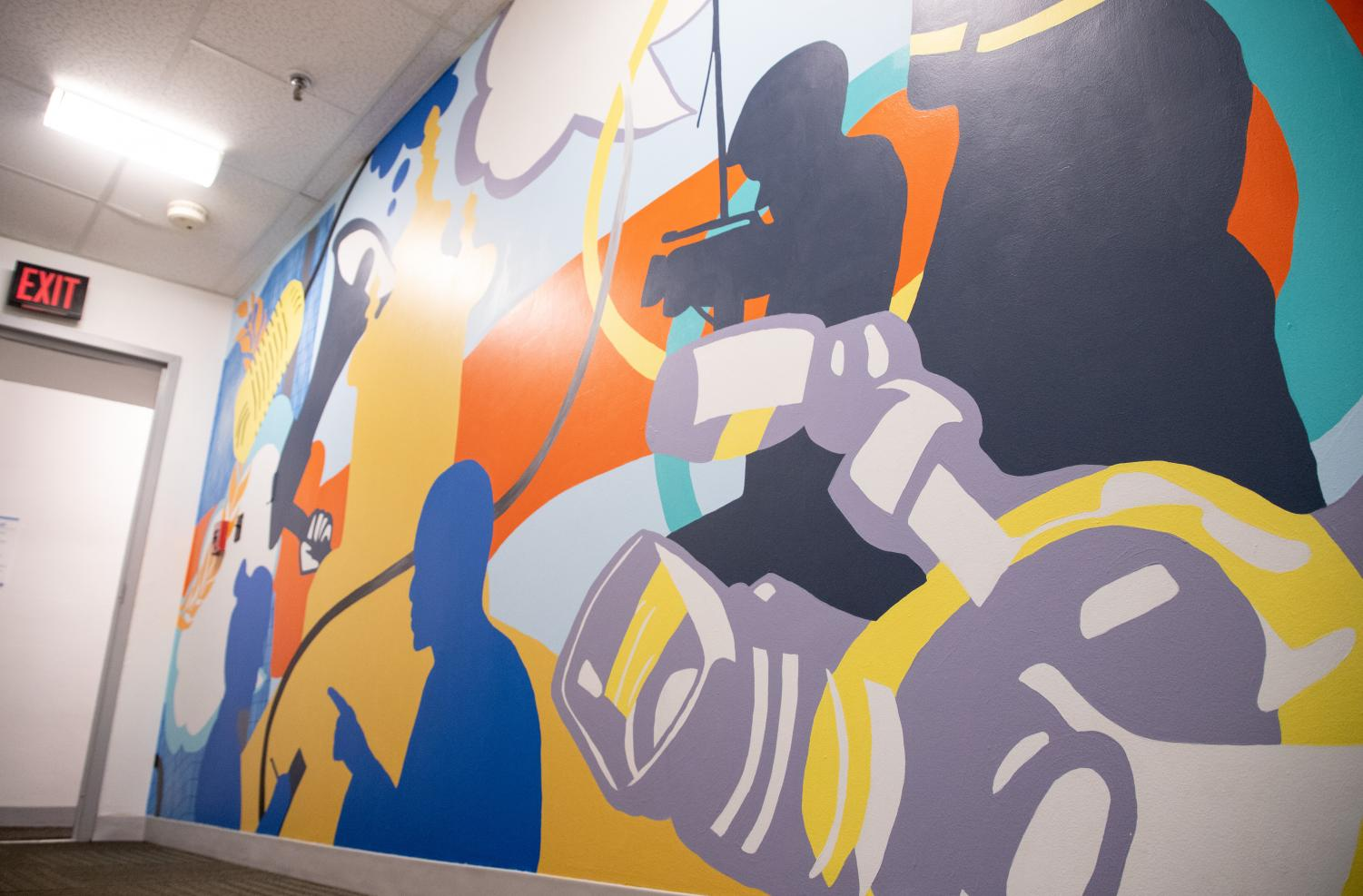 A new mural is in progress on the first floor of Holmes Hall, which houses the School of Journalism.