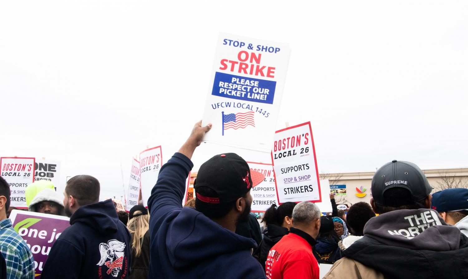 Strikers+hold+up+signs+at+the+rally+in+front+of+the+Dorchester+Stop+%26+Shop+on+April+18.