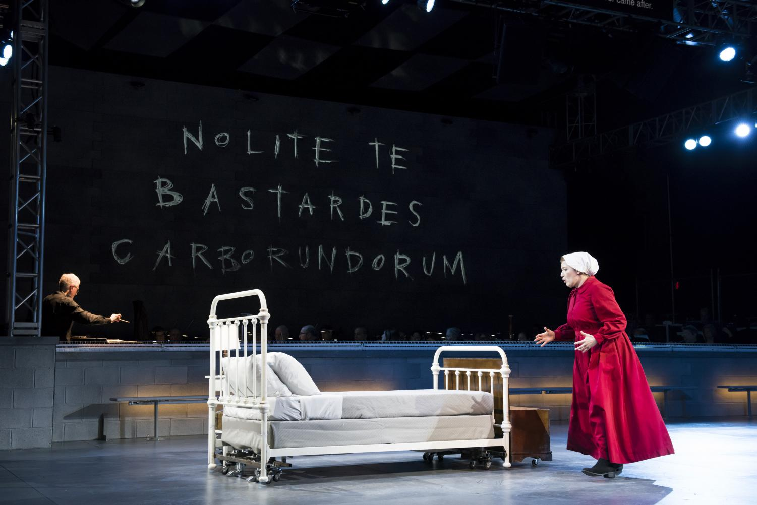 Offred, played by Jennifer Johnson Cano, sees her room for the first time in Boston Lyric Opera's production of Margaret Atwood's seminal dystopian novel.