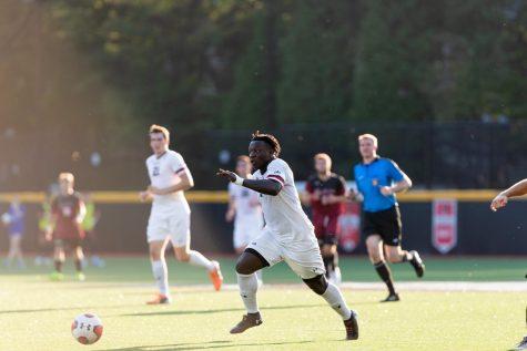 Timothy Ennin pursues the ball during a match against Charleston College.