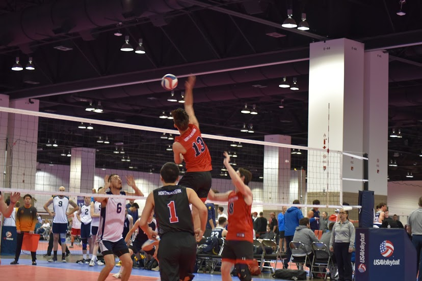 Junior+middle+blocker+Quinten+Grable+goes+up+for+the+ball+during+a+game+at+the+national+championship.