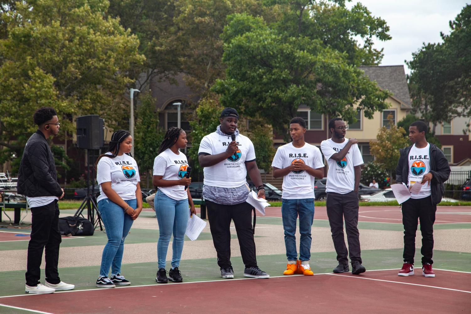 Organizers for the R.I.S.E. Rally against community gun violence gathered with Boston residents in Roxbury Saturday.