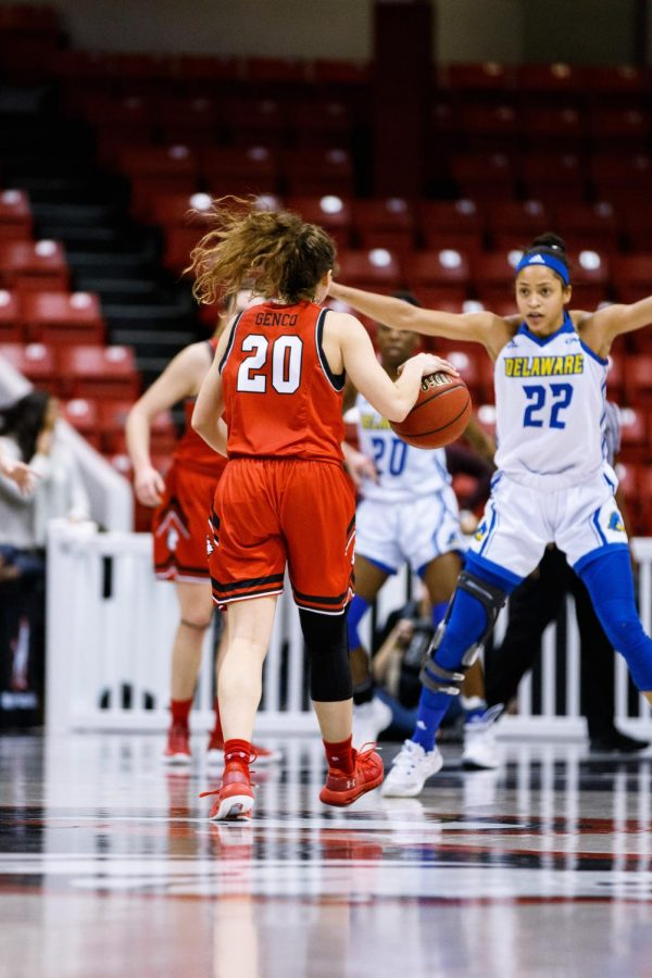 Graduated guard Jess Genco, one of the players the Huskies will have to play without this season, dribbles forward in a game against Delaware last year.