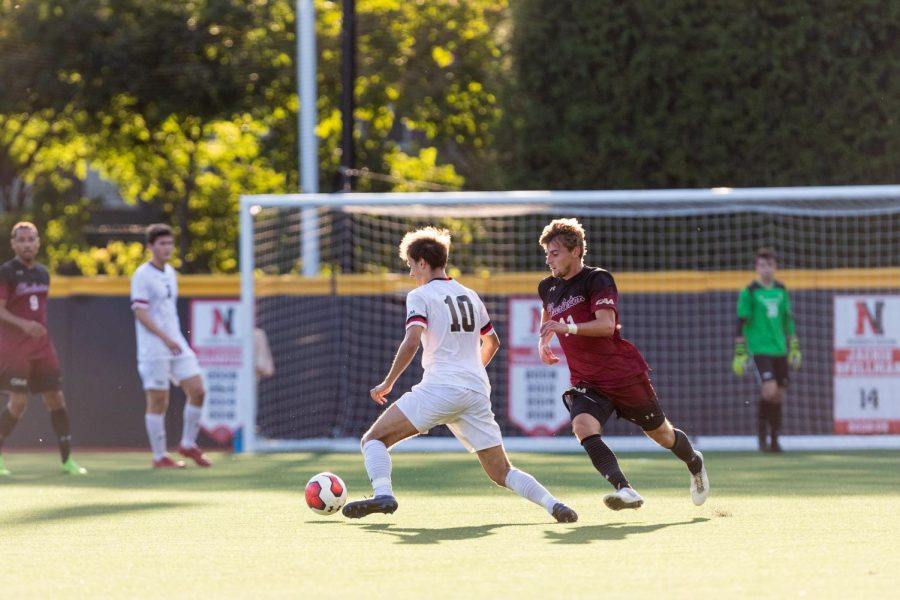 Sophomore midfielder Jacob Marin-Thomson sidesteps a defender in a game against Charleston College.