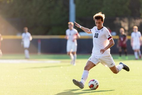 Jacob Marin-Thomson strikes the ball during a match against Charleston College.