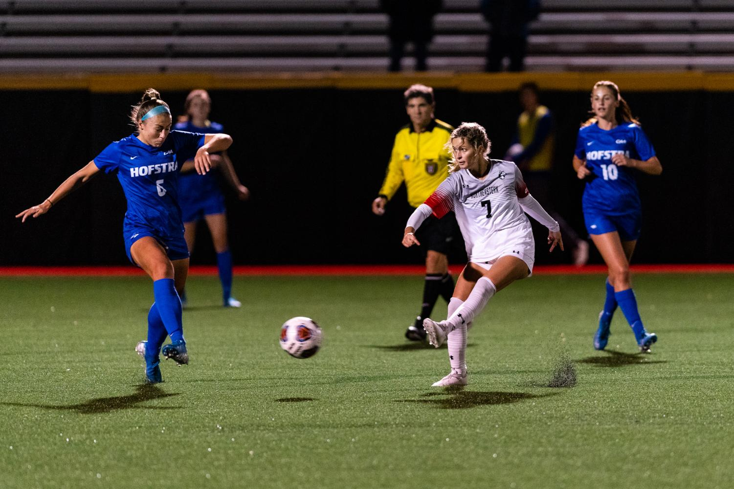 Senior midfielder Emily Evangelista lines up a pass in a game against Hofstra earlier this season.