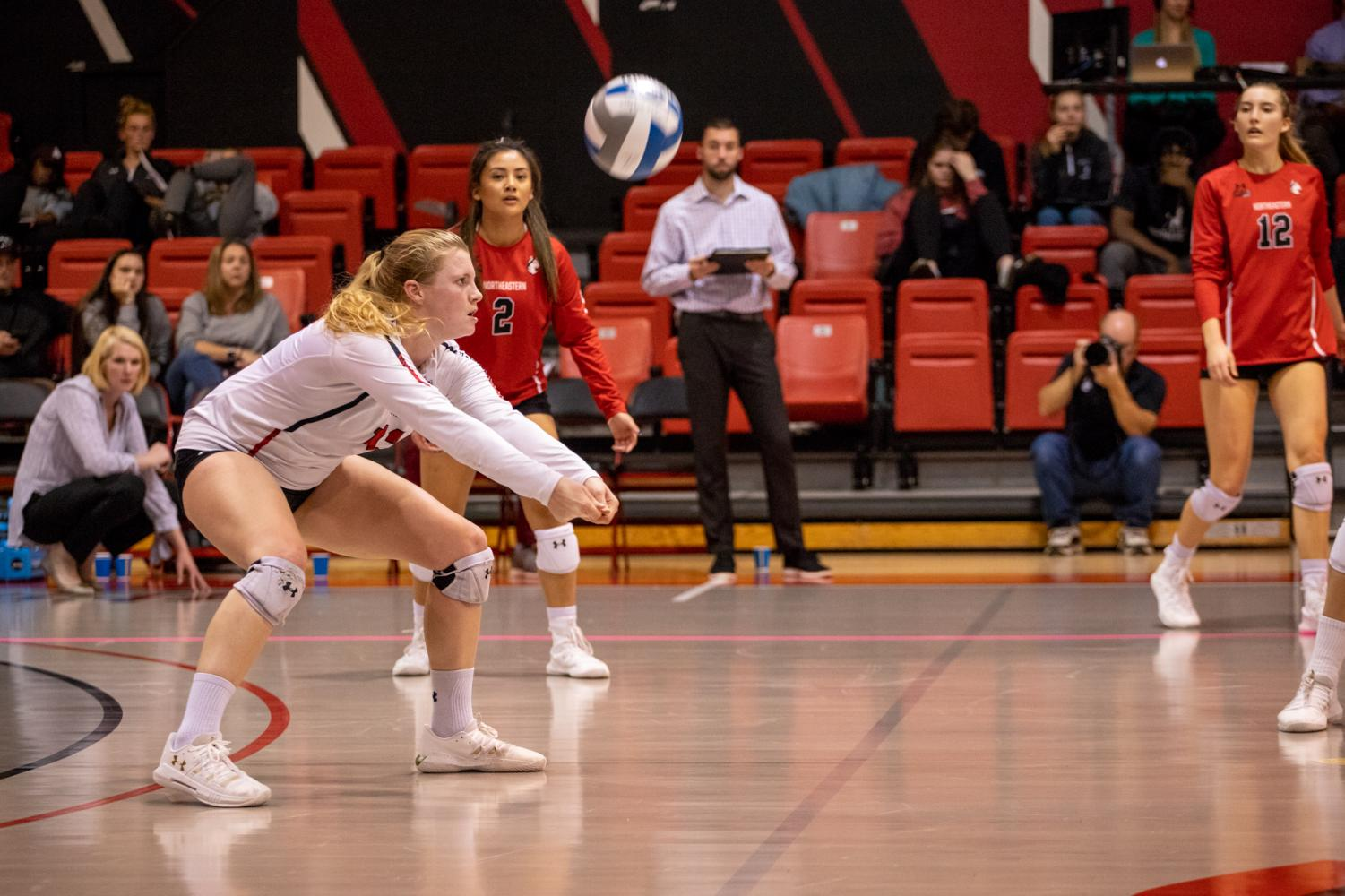 Senior defensive specialist Clare Lund goes for a dig in a game earlier this season versus Elon.