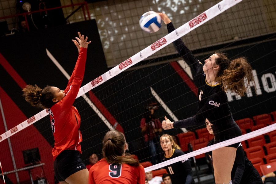 Nailah+Jenkins+goes+up+for+a+block+in+a+match+against+Towson+earlier+in+the+season.