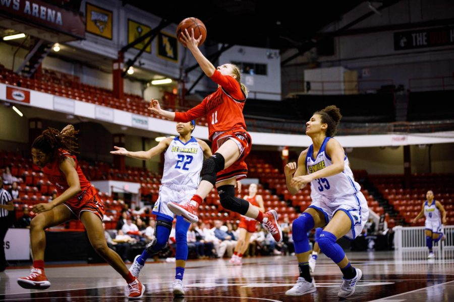 Junior guard Stella Clark goes for a layup in a game against Delaware last season.