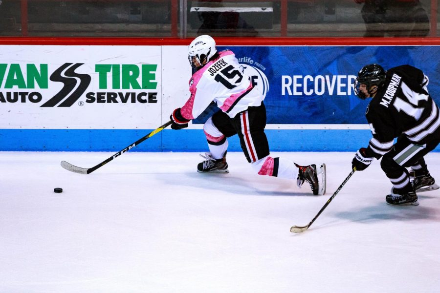 Senior forward Grant Jozefek rushes for the puck in a game against Providence last season.