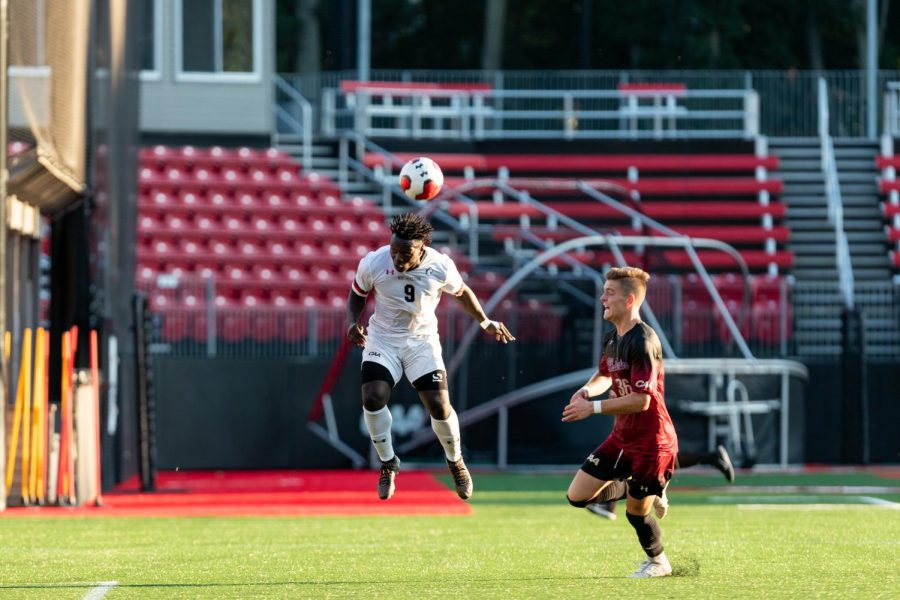 Redshirt freshman forward and CAA Rookie of the Year Timothy Ennin goes for a header in a game against Charleston earlier this season.