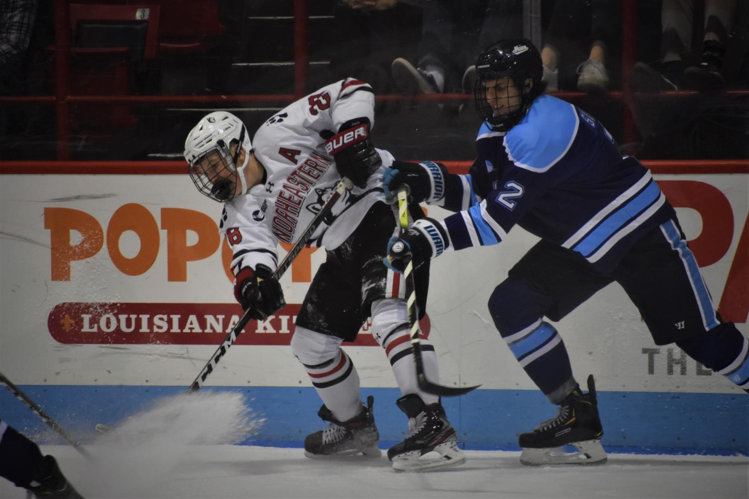 Junior forward Zach Solow passes the puck to a teammate in heavy traffic in today's game versus Maine.