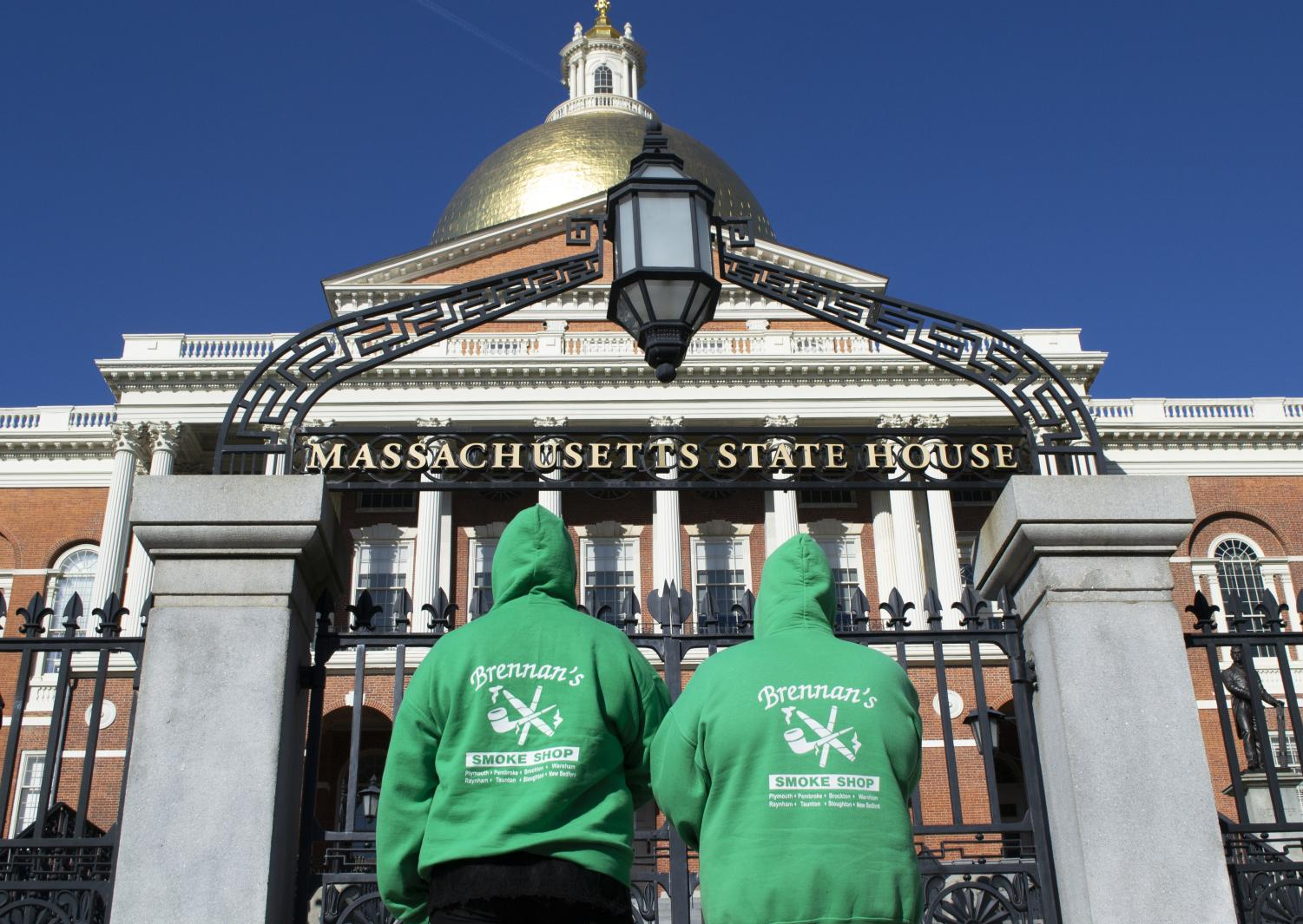 Kristen Brennan and Hannah Magnuson, both employees at Brennan's Smoke Shop, stand in front of the Massachusetts State House in protest of the menthol ban.