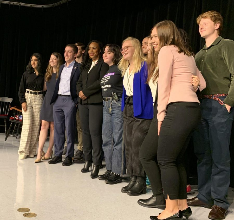 Rep. Ayanna Pressley poses for a photo with organizers and attendees at the BU College Democrats Election Day Forum.