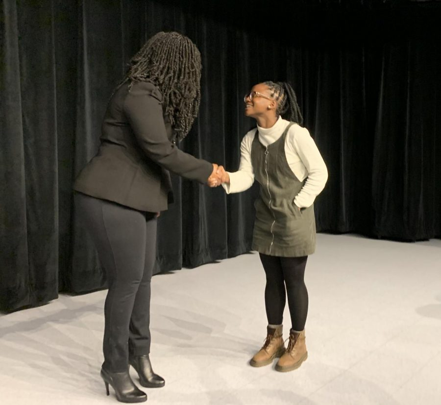 Pressley+shakes+hands+with+an+attendee+at+the+BU+Election+Day+Forum.+