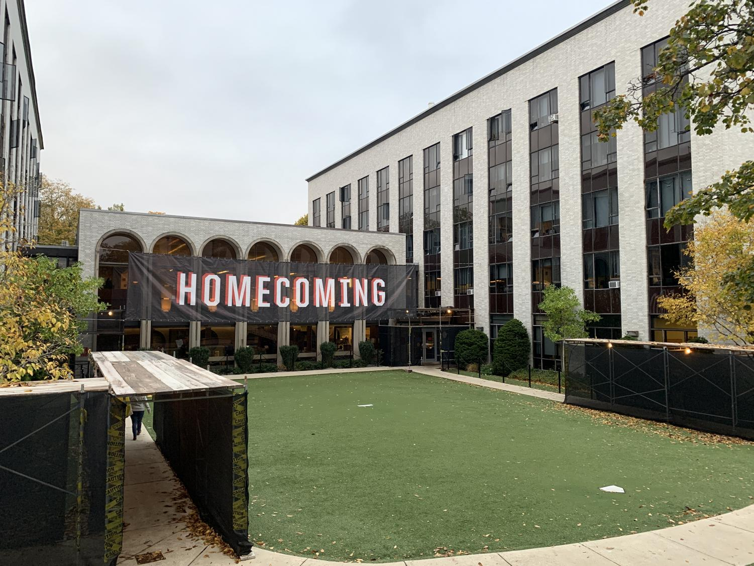 A Homecoming banner hangs on the side of Speare Hall.