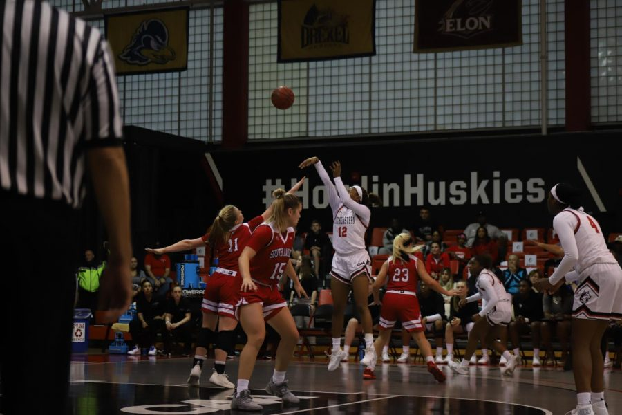 Senior forward Ayanna Dublin puts up a 2-pointer in traffic against members of the South Dakota defense.