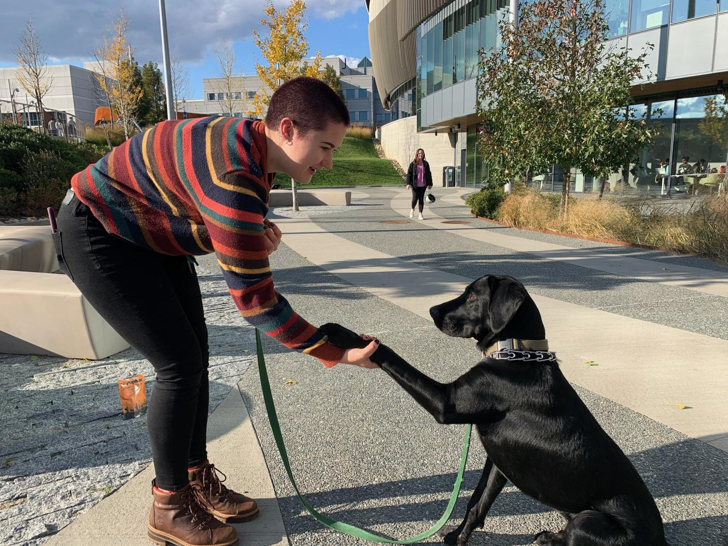 Amy Hayward and her dog Forrest play outside of ISEC.