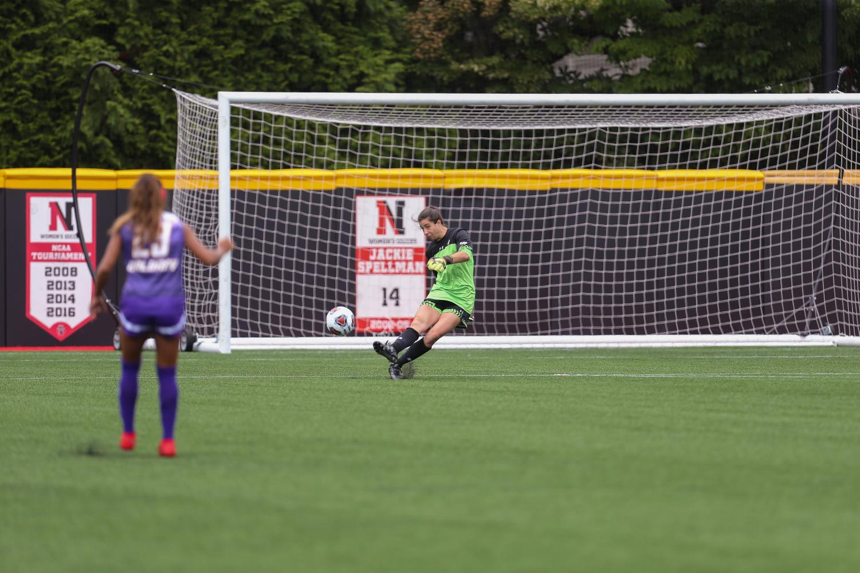 Women's soccer goalkeeper Megan Adams kicks the ball away from her goal in a game earlier this season.