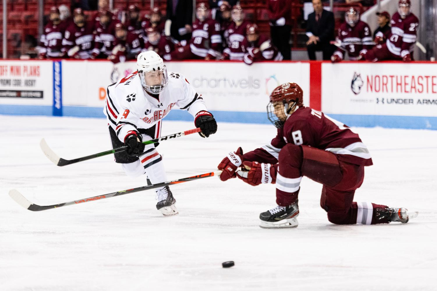 Sophomore center Tyler Madden shoots the puck past a defender in a game earlier this season versus UMass.