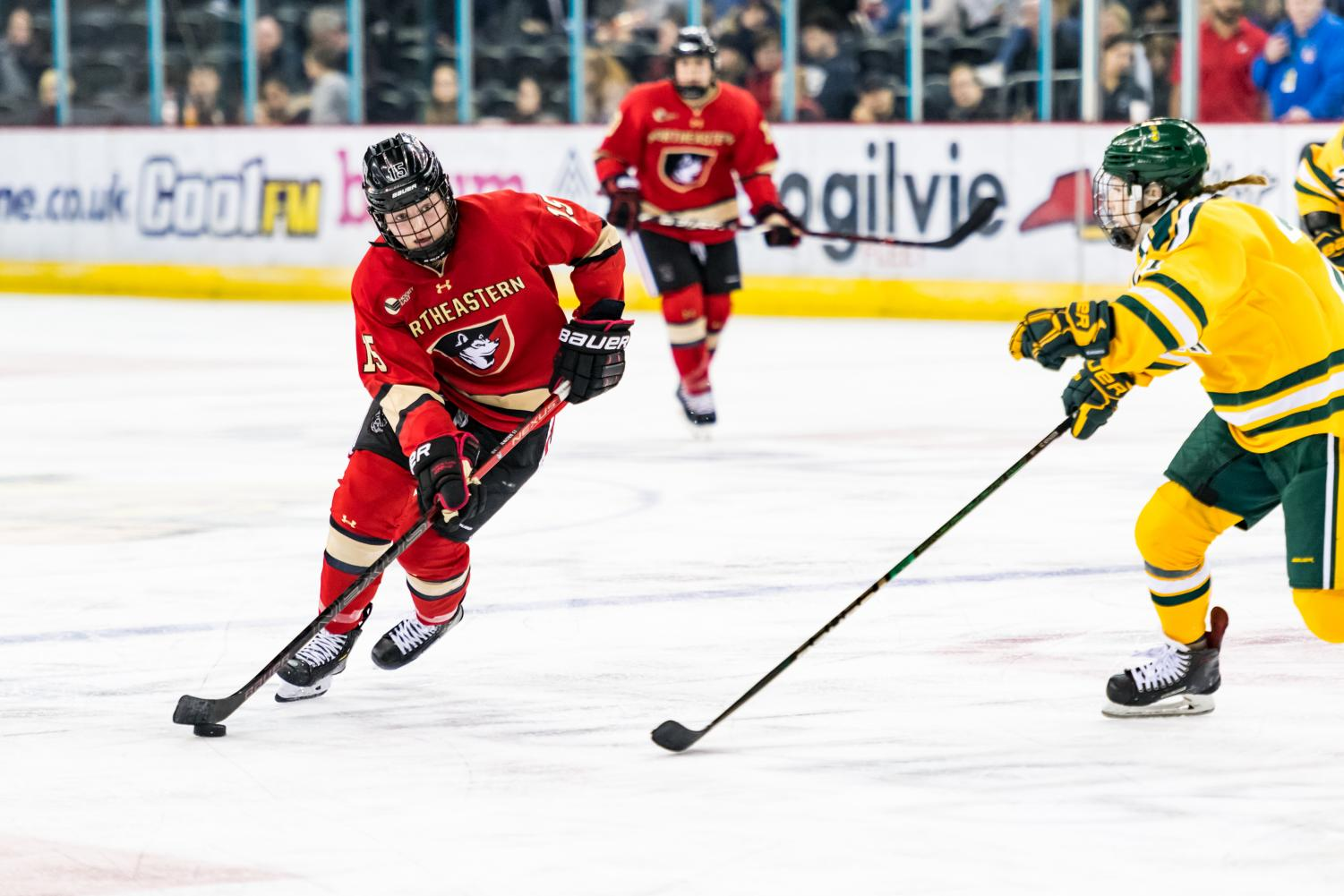 Sophomore forward Mia Brown handles the puck against Clarkson in last season's matchup in Belfast.
