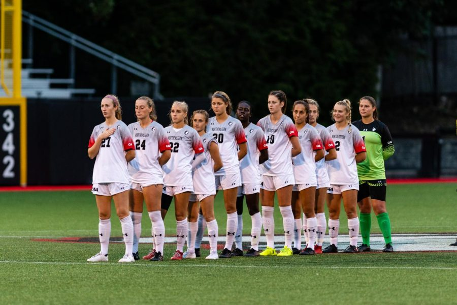 The+women%27s+soccer+team+lines+up+on+the+field+before+a+game+against+Hofstra.