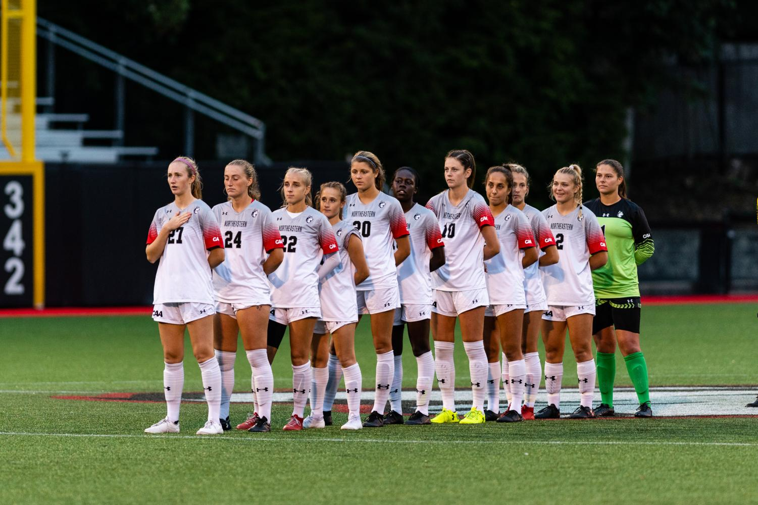 The women's soccer team lines up on the field before a game against Hofstra.