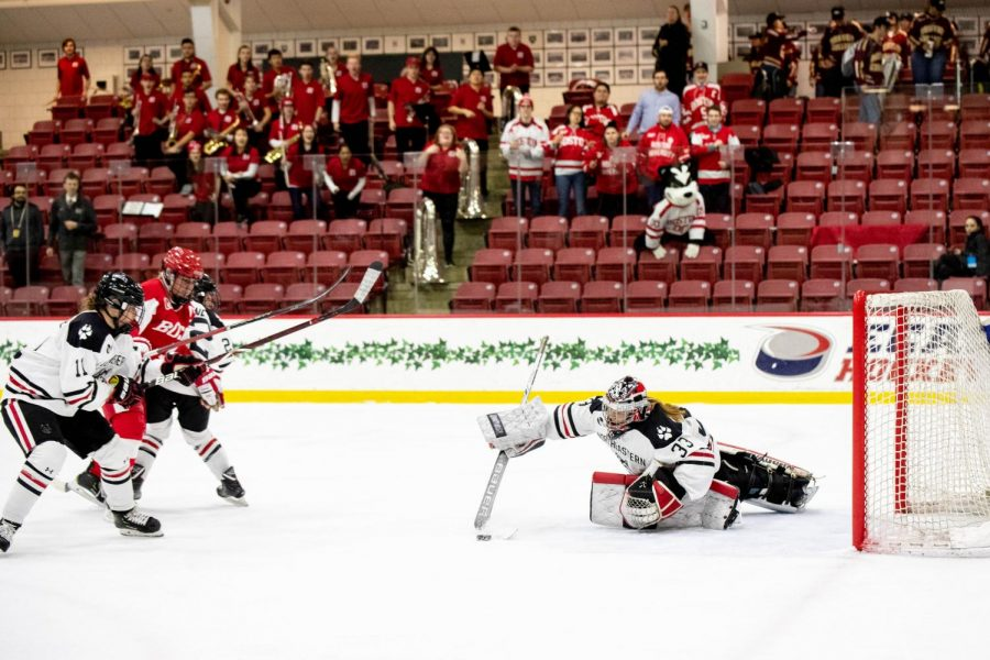 Frankel clears the puck out of the crease during a game against BU last season.