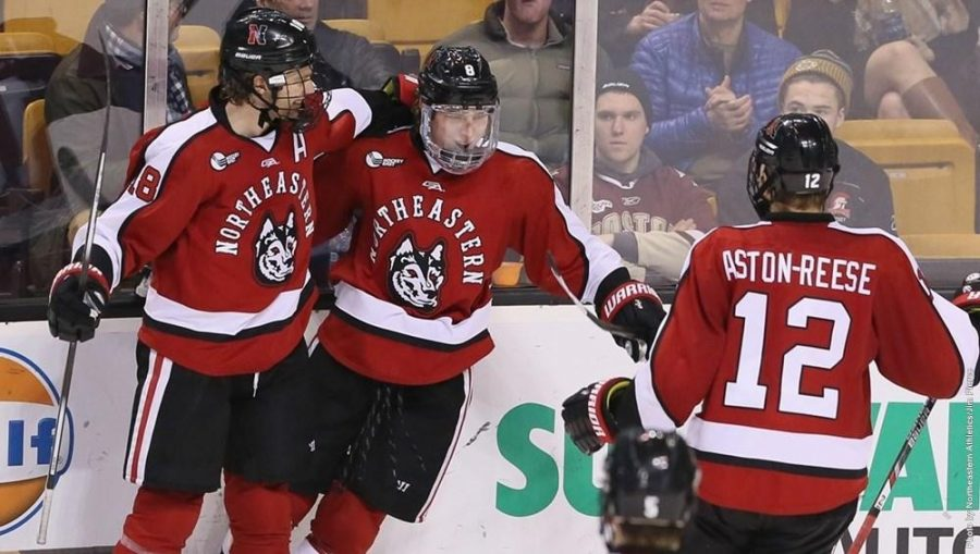 Zach Aston-Reese celebrates with Adam Gaudette (8) and John Stevens (18) as the Huskies beat Harvard in the 2016 Beanpot consolation game.