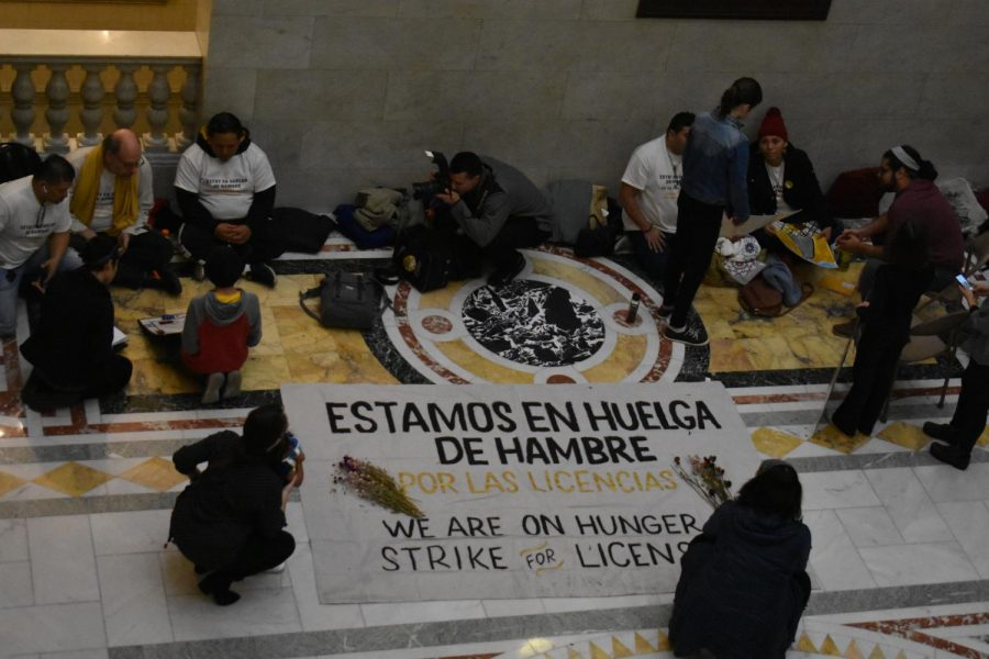 Hunger strikers line the floor of the State House with signs protesting the 15-year wait to legalize driver's licenses for undocumented immigrants.
