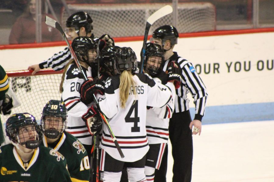 The+NU+skaters+celebrate+their+second+of+three+goals.+
