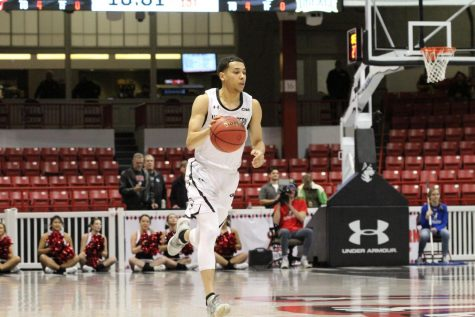 Roland breaks Northeastern record with 42 points in win against Harvard