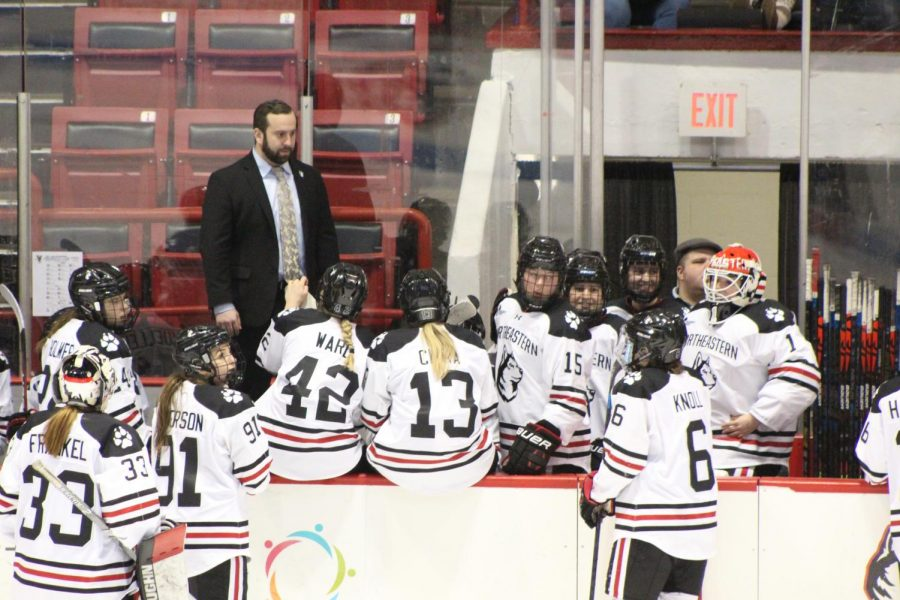 The Huskies gather during one of the multiple goal reviews of their quarterfinals clinching win.
