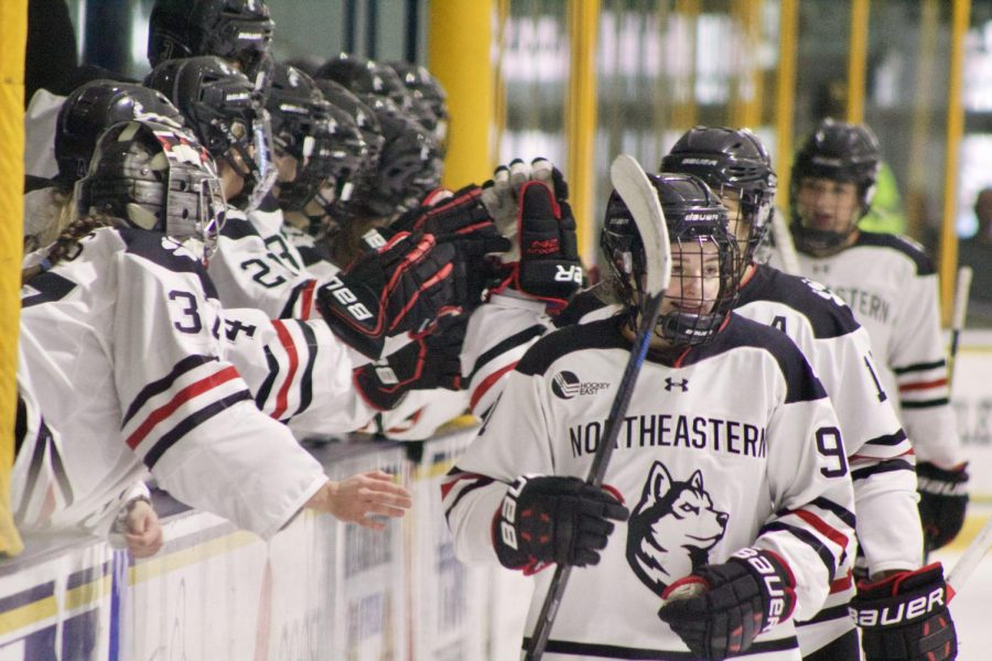 Peyton Anderson and the NU Huskies celebrate their ninth goal of the contest.