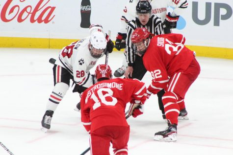 NU junior forward Zach Solow and BU freshman forward Wilmer Skoog face off at the 2020 Beanpot final game where NU won 5-4.