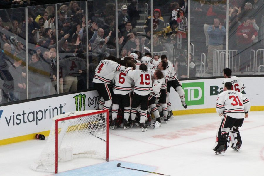 The Huskies, with Harris and Pantano in the middle, celebrate their third straight Beanpot.