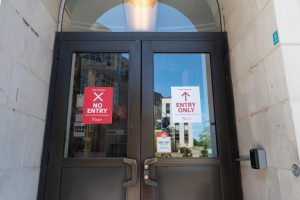 Signs regulating one-way traffic have been affixed to most doors throughout campus.