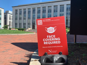 Signs instructing campus visitors to wear a mask are placed around campus.