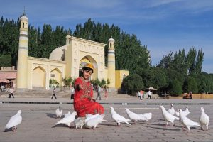 A child feeds doves in Kashgar, a historic city in the Uyghur Autonomous Region.
