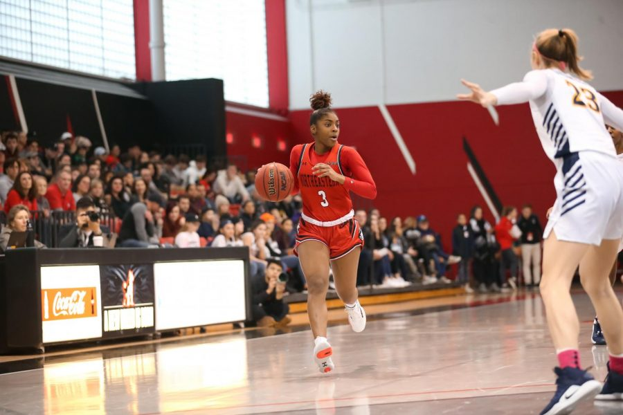 Sophomore guard Mossi Staples surveys the court as she nears the 3-point line in a game against Drexel last season.