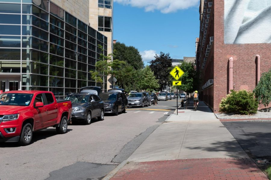 A long line of cars stretches the length of Leon Street during move-in on Aug. 30.