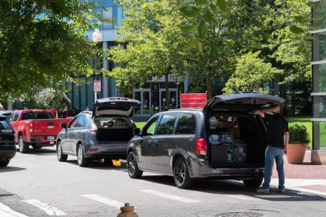 Families unload items from cars as they move into Willis Hall and West Village F on Aug. 30.