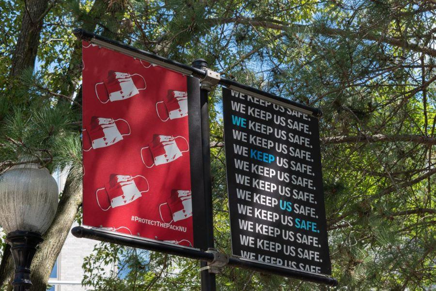 This sign outside Snell Library suggests that community members wear face coverings to keep the community safe.