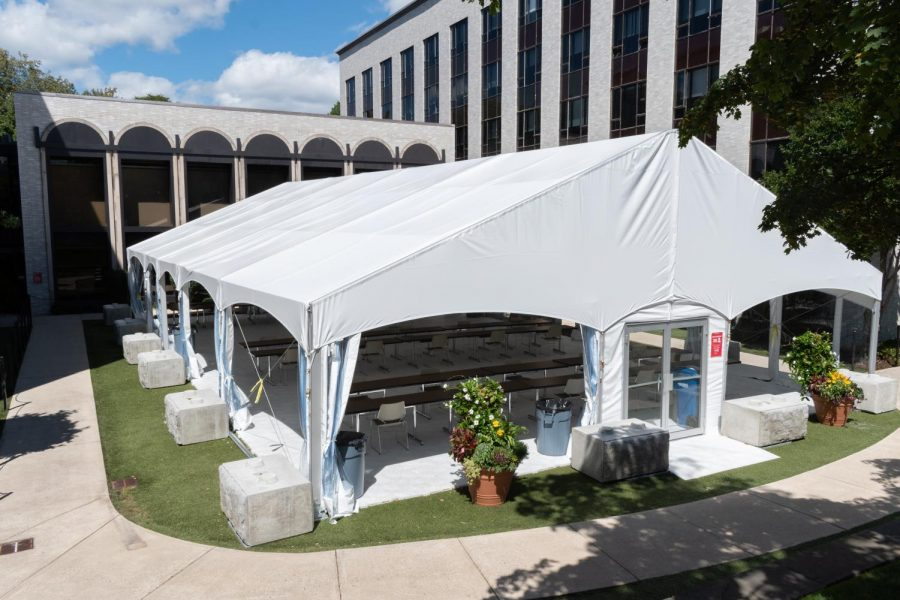 A tent set up outside Speare Hall can accommodate 30 people with the sides rolled up, or 25 with the sides rolled down for inclement weather.