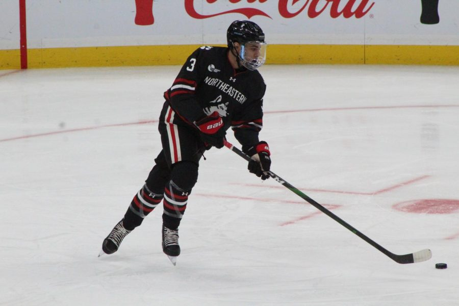 Struble looks to pass in the first game of the 2020 Beanpot against Harvard.